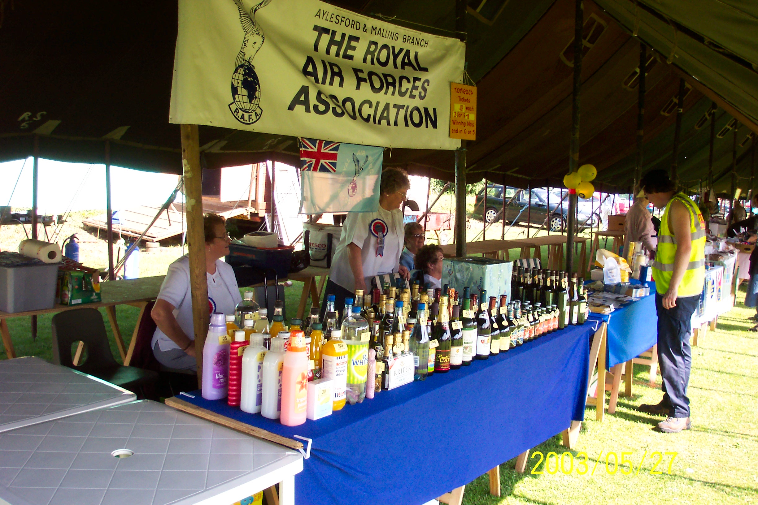 Pauline (seated, left) and Margaret (standing) running branch stall at local fete