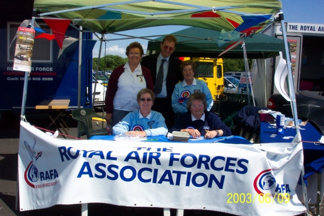 Pauline (standing, left) and Margaret (seated, right) at Biggin Hill Air Fair