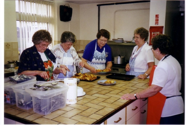 Margaret (left) and Pauline (centre) preparing food for members of RAF Central Band